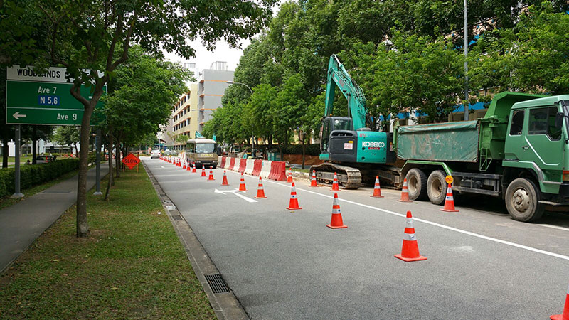 Pipeline laying on the side of the road in Singapore downtown